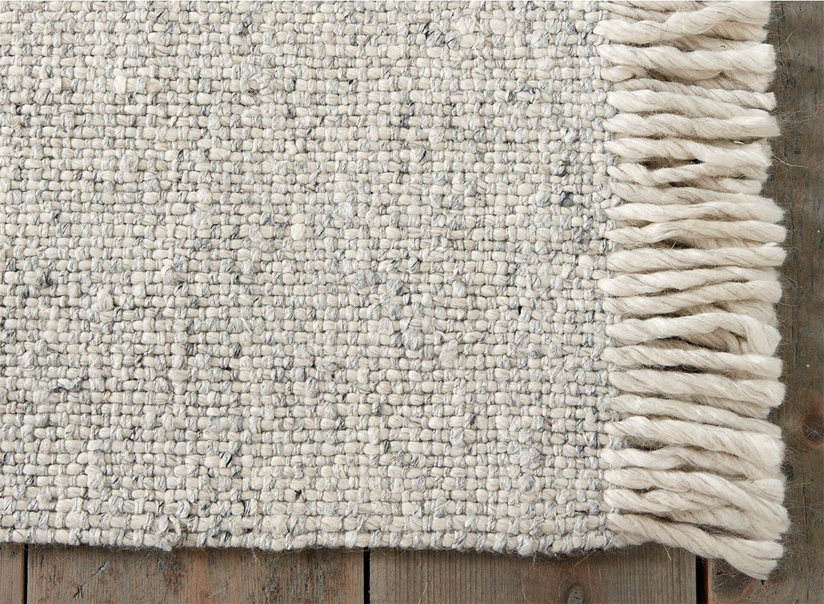 10. - Harrogate Wool Tassel RugJust nudging in at the upper end of price range, this wool and viscose blend rug from The White Company has a slubby texture with a subtle sheen and feels beautifully soft underfoot. The neutral colour would blend seamlessly into lots of different rooms - I'd use it to add warmth and texture to a pared back minimalist bedroom.The White Company - from £495