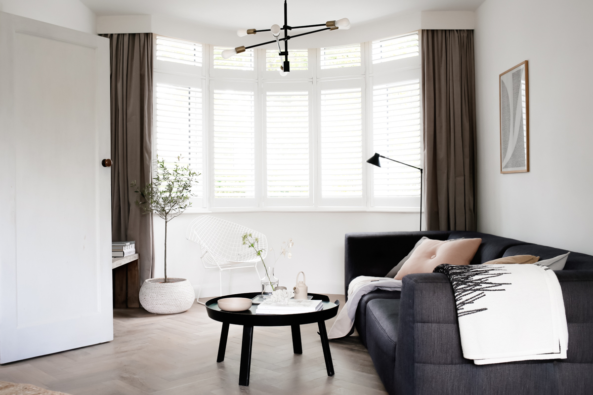 Shutters by Apollo Blinds in bay window - Design Hunter living room-1-8.jpg