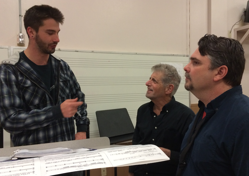 Stefan Cwik, Stephen Paulson, and Russ deLuna discuss Cwik's English horn concerto during rehearsal