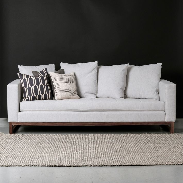 This is an amazing sofa from West Elm upholstered in Cement. The long continuos cushion adds a modern flair but the wood base feels rustic which is a nice balance.
