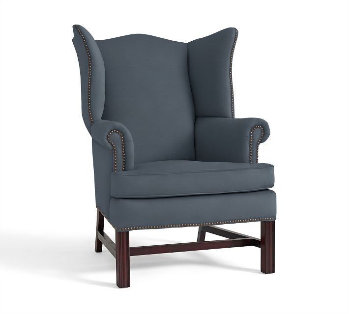 I love this wing chair from Pottery Barn upholstered in brushed canvas color harbor blue. This piece has a colonial feel which is a nice contrast to the modern sofa. I love the nailhead details!
