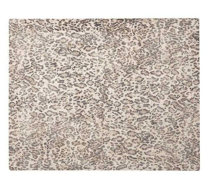 This Cheetah print inspired carpet is from Pottery Barn. This is the perfect grounding element for all the pieces above. It is always fun to add an animal print to any space.