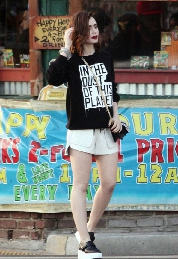 Lilly Collins wearing a shirt referencing a book by philosopher Eugene Thacker.