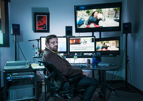 Brent White in the editing room  where he worked on the Paul Feig movie  Spy . (Photo: Damon Casarez for  The New York Time s)