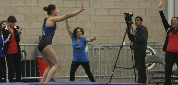 Mary Lou Retton clinches another stuck dismount