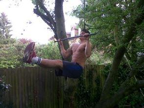 Deyan doing pull ups in his garden: London, UK