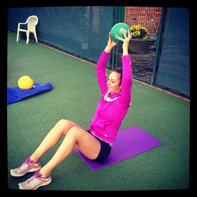 Michaela keeps strong form during her regular core workout