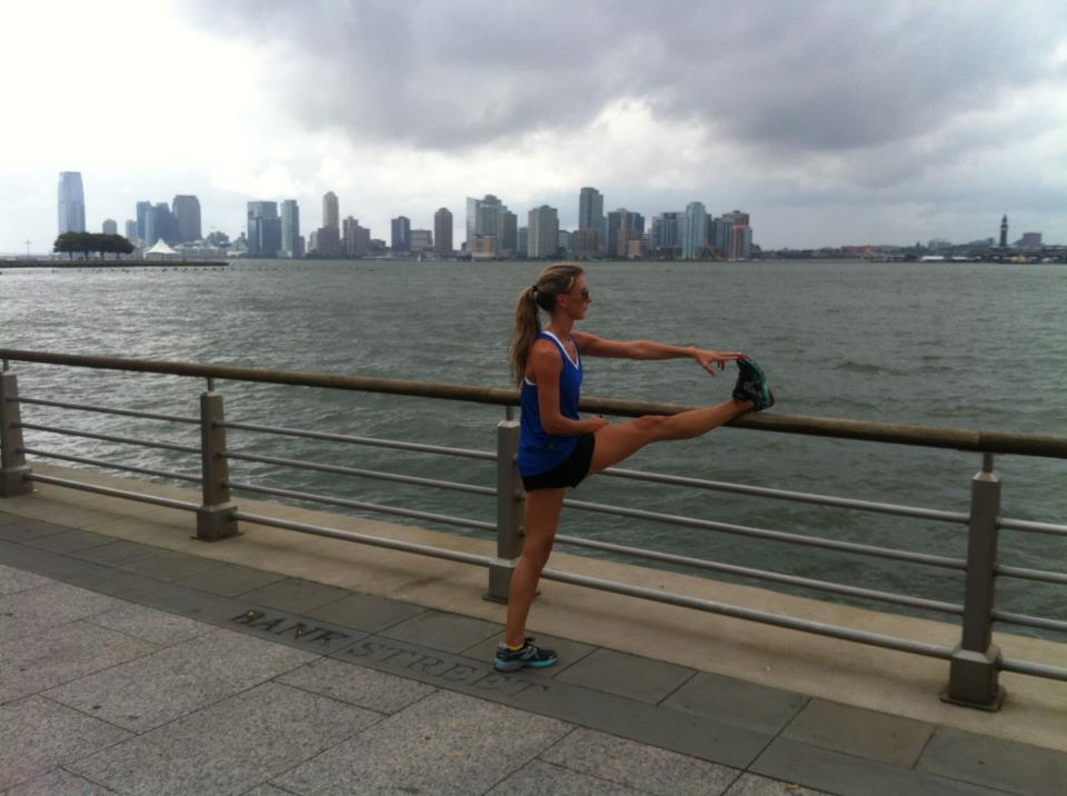 Alicia stretching after her run on the Hudson River, NYC