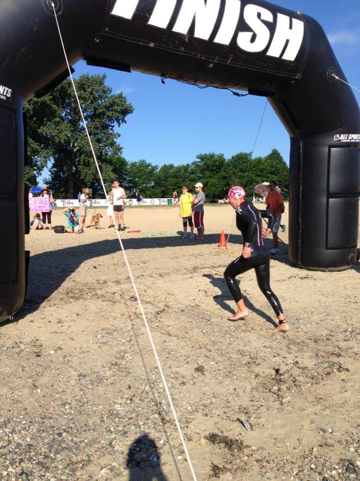 Coach Medena coming into T1 at the Boston Tri