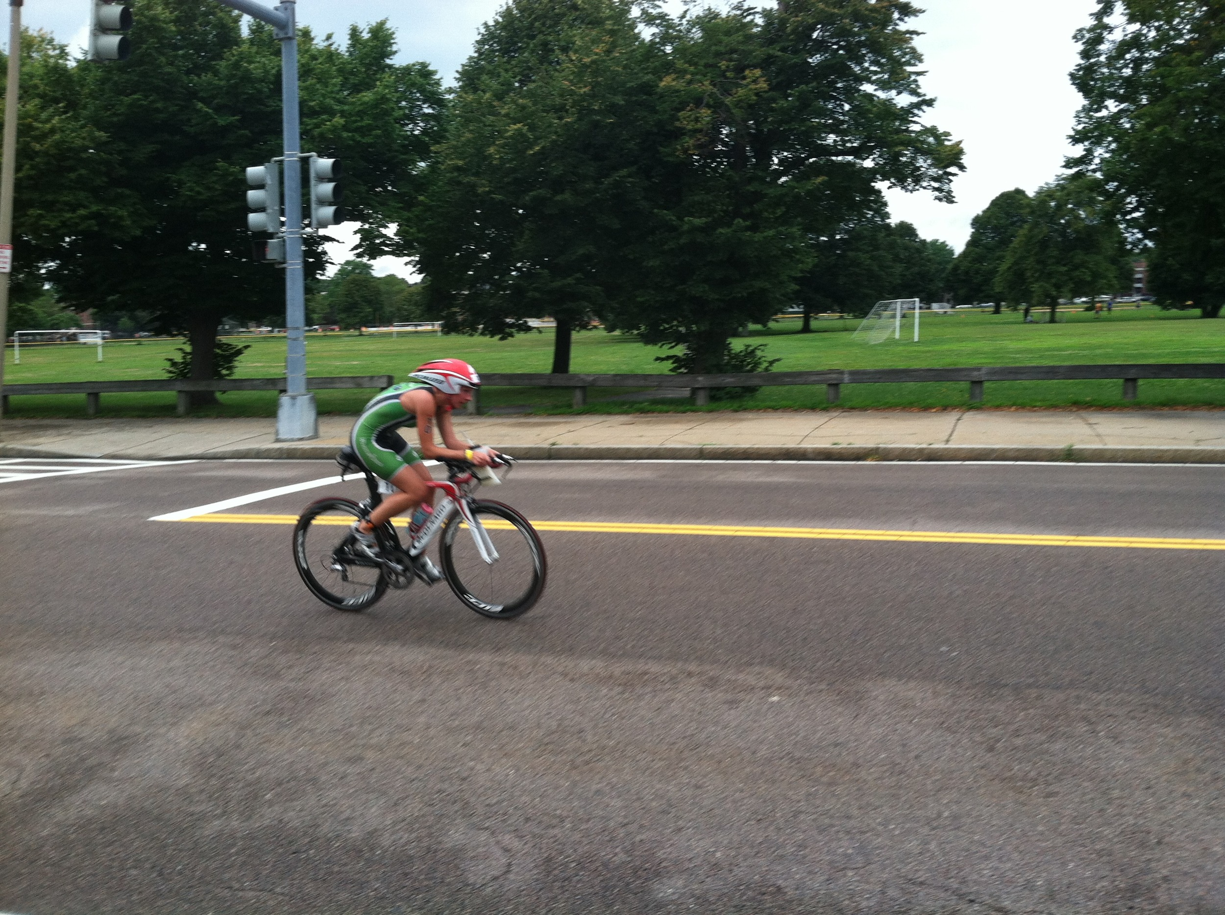 Coach Medena on the bike section of the Boston Tri