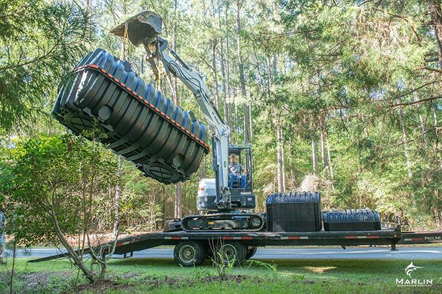 Unloading an Infiltrator IM-1060 Septic Tank and Quick 4+ Leach Field Chamber for an installation in Aberdeen NC.