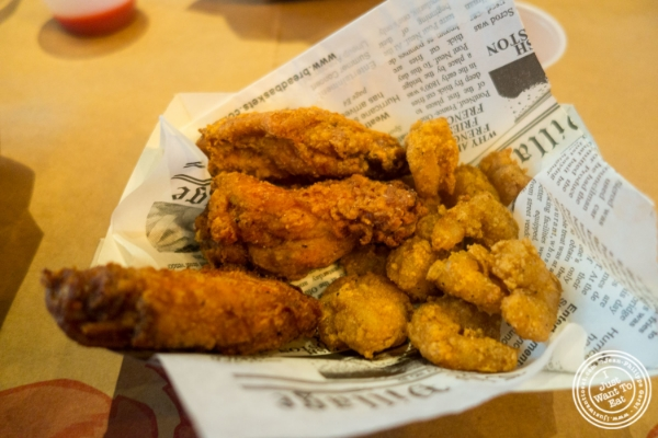 Wings and popcorn shrimp at Claw Daddy's in New York, NY