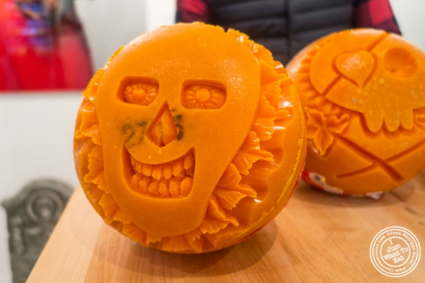 Artist Krai carving mimolette for   Halloween at The French Cheese Board