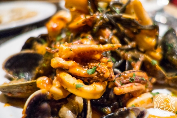 Black linguine with seafood at  Petrarca Cucina e Vino, Italian restaurant in Tribeca, NYC, New York