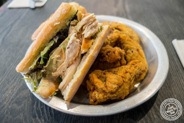Chicken sandwich and wings atPoulette, Rotisserie Chicken, in Hell's Kitchen, NYC, New York