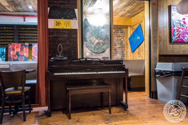 Piano at Burger Joint W8th Street in NYC, New York