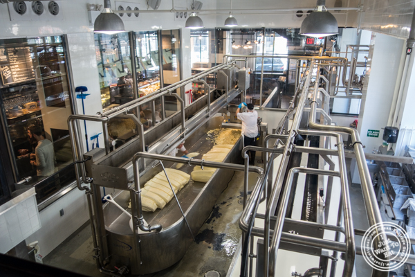 Making cheese at  Beecher's cheese shop in NYC, New York