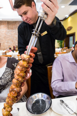 Chicken and pork sausage at Churrascaria Plataforma in NYC, New York