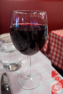 Glass of Bordeaux at Tout Va Bien, French Restaurant in NYC, New York