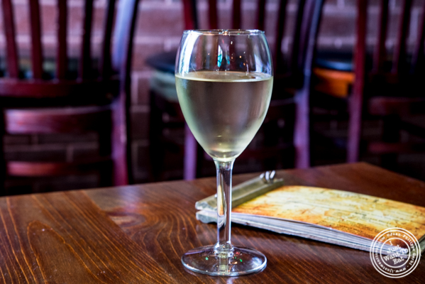 Glass of Cote Mas Sud De France 2013 at Off The Hook, Raw Bar and Grill in Astoria, Queens
