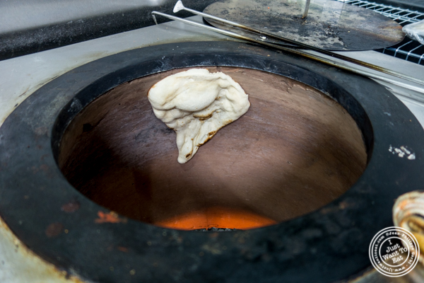Making nan in a tandoor oven at Surya, Indian restaurant on Bleecker, NYC, New York