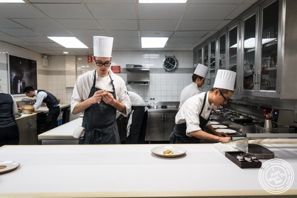Plating in the kitchen of Eleven Madison Park in NYC, New York