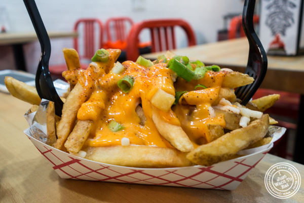 Sriracha hinted cheesy fries at IWF - International Wings Factory on the Upper East Side