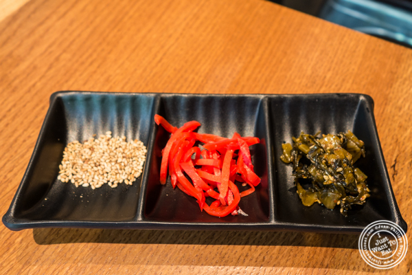 Condiments for ramen at Ramen Zundo-Ya in NYC, New York
