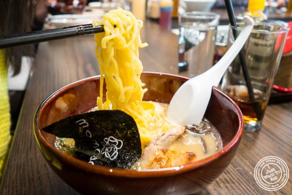 Noodles in tonkotsu ramen at Momosan Ramen and Sake in NYC, New York