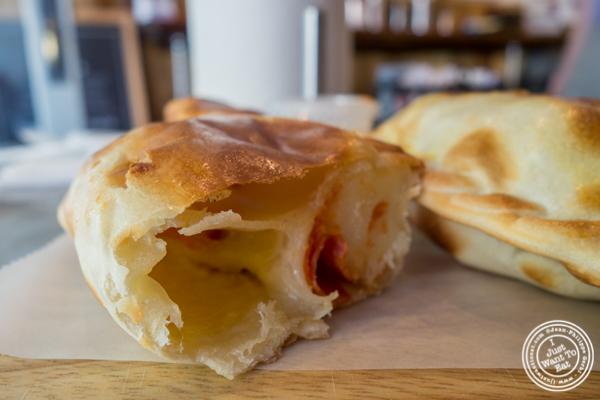 Pepperoni and cheese empanada at Empanadas Café in Hoboken, NJ