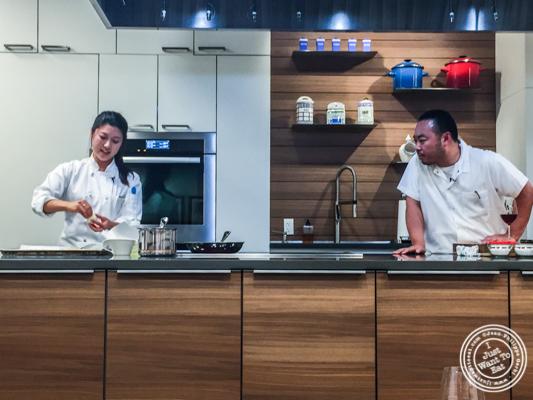 Diana Kang making donuts watched by Chef Hooni Kim at De Gustibus Cooking School at Macy's, NYC, NY