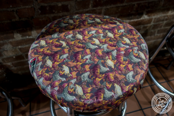 Stool decorated with roosters at Tehuitzingo in Hell's Kitchen