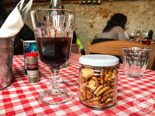 Walnut wine and crackers at La Ferme à Dédé in Sassenage, France