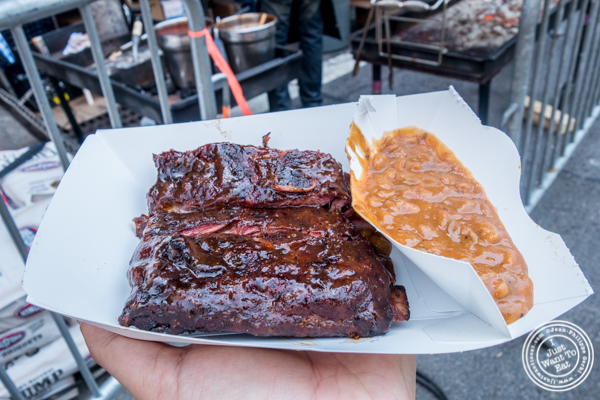 St Louis spare ribs on the grill from Dinosaur BBQ at The Big Apple BBQ Block Party