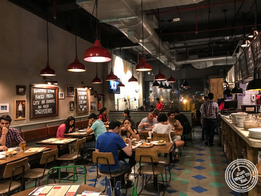 Dining room at Jamie's Pizzeria at The Ambience Mall in Gurgaon, India