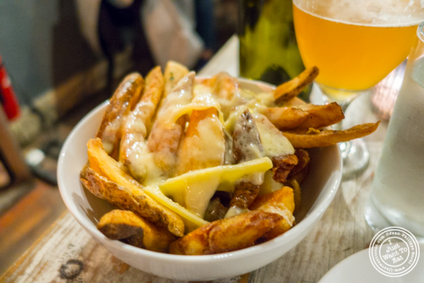 Garlic fried potatoes with raclette at LIC Market in Long Island City