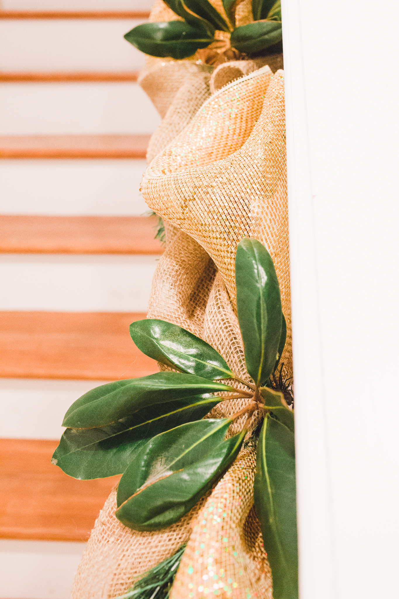 Burlap, ribbon, magnolia trimmings on the staircases; we have since added purple ornaments.