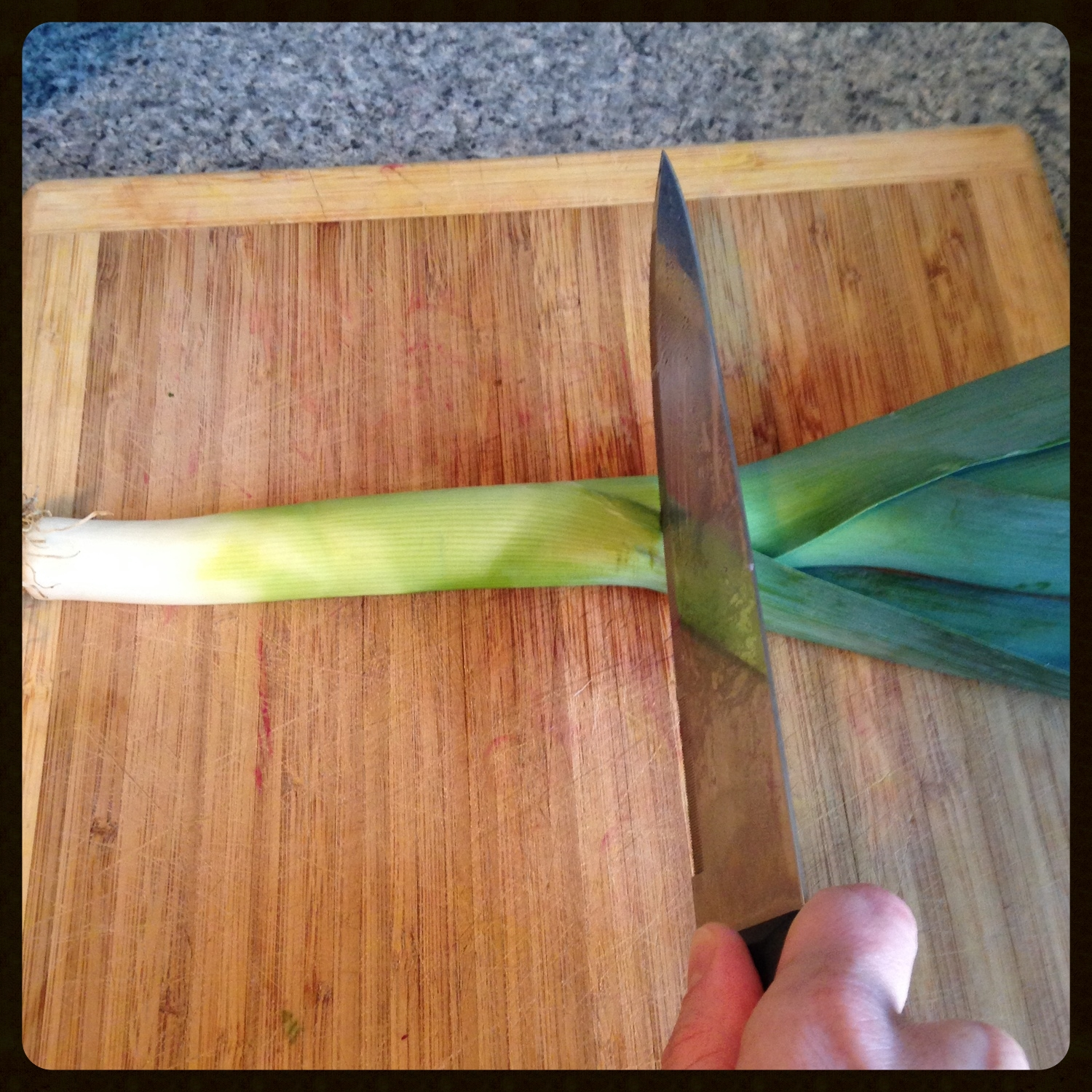 Discard the green leafy part of the leek.
