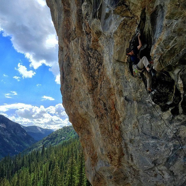 Climbing a 5.13aon Independence Pass near Aspen, Colo., in June. Photo by Chris Schulte.