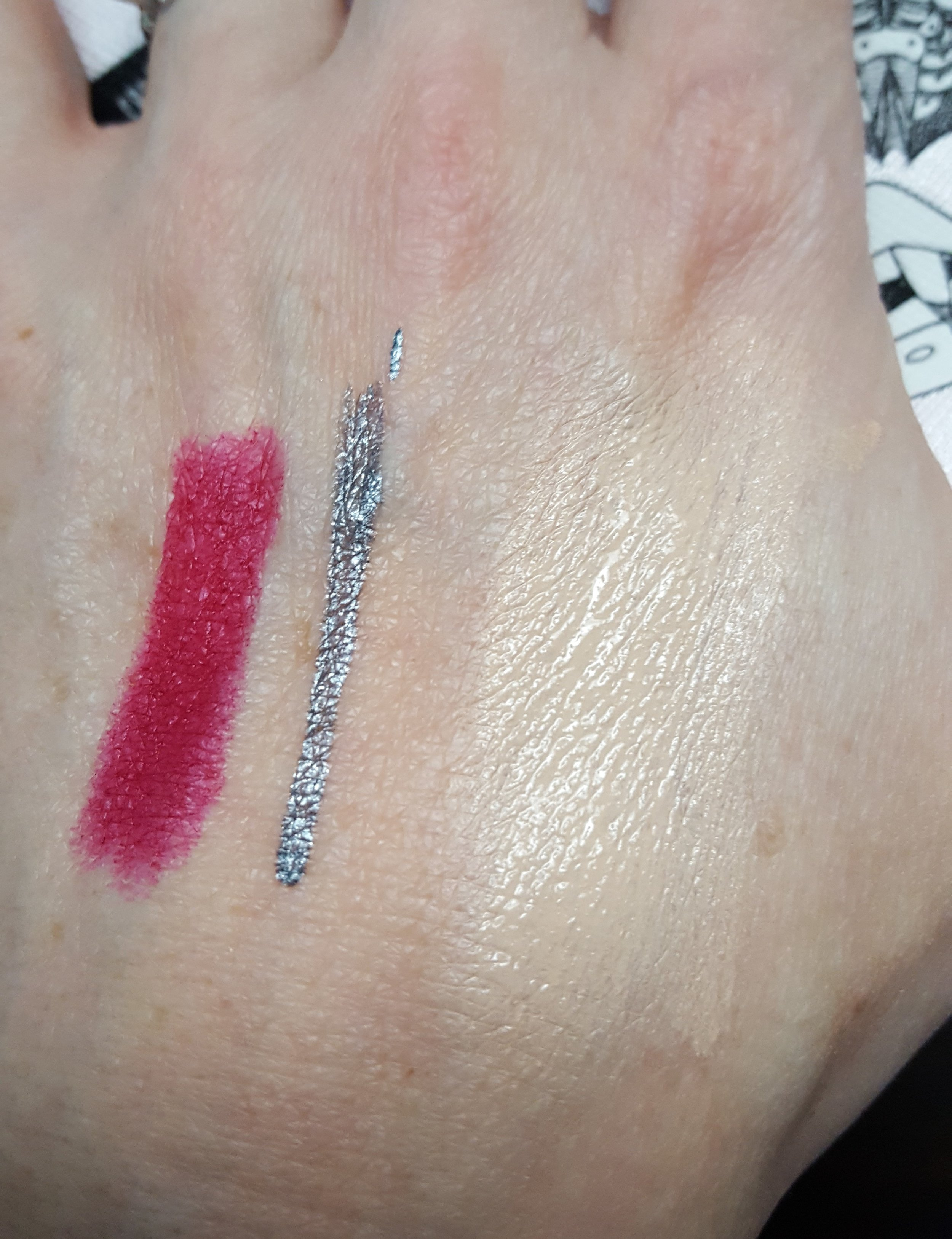 Left to Right: Tre'Stique lip crayon; NYX Vivid Brights eyeliner; Makeup Forever foundation