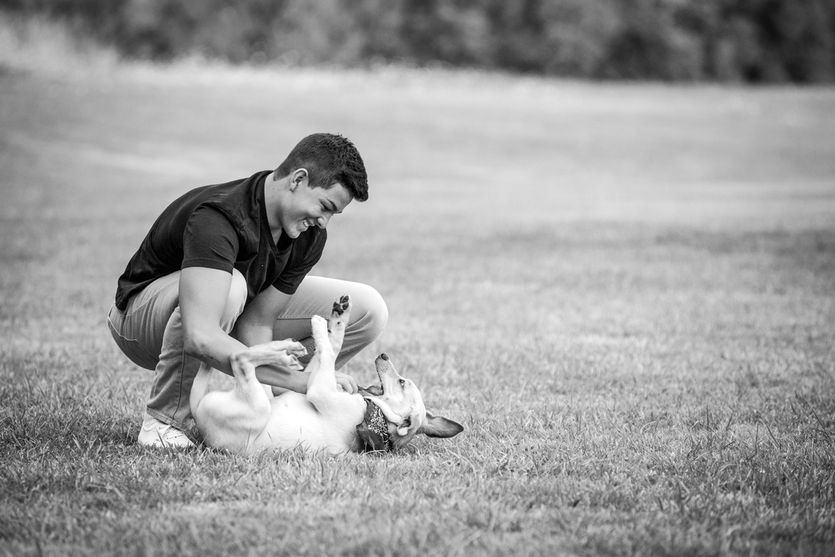 corvallis, oregon-senior portraits-playing with dog-outdoors-handkerchief