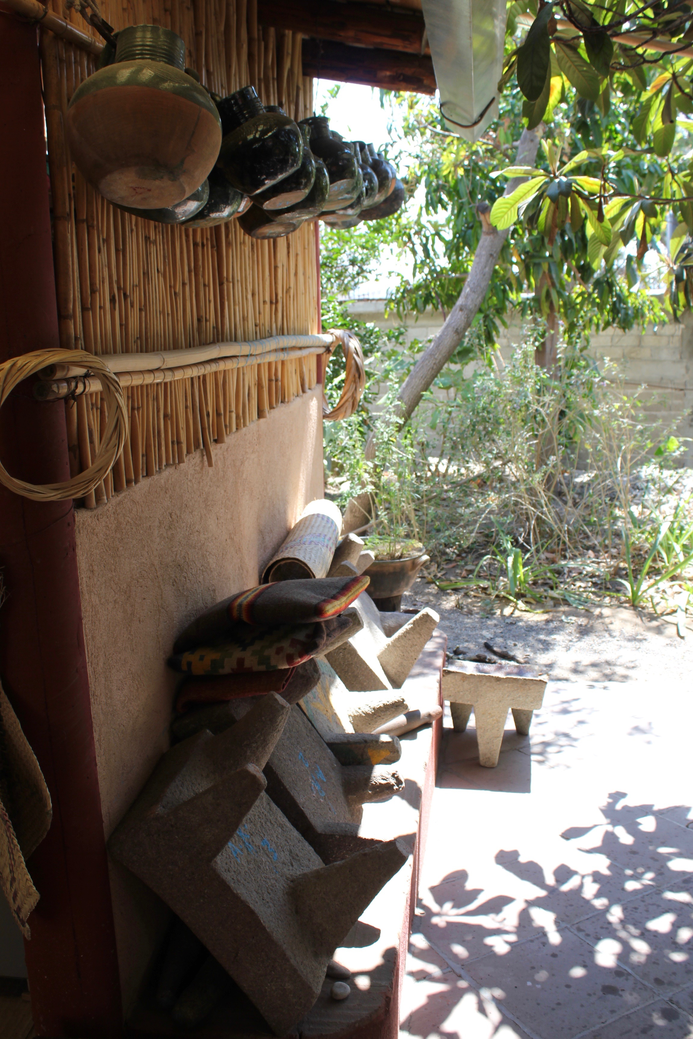 A metate for every job.  The cushions piled on top are for sparing your knees during grinding.