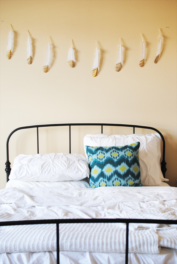Set the mood for a Cupid's Arrow-themed breakfast in bed with a gold-dipped feather garland.