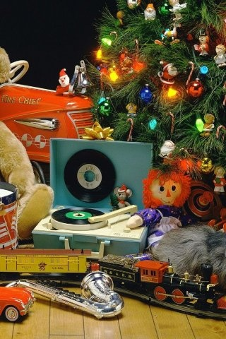 """""""Oh boy! A Zeppelin!"""" Theme party decor inspiration: children's vintage toys under a traditional tree."""