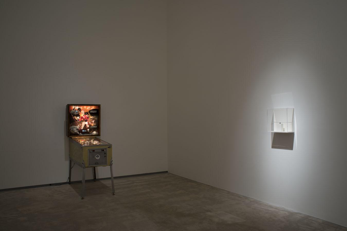 Musketball! , 2012,  Pinball machine, Plexiglas, acrylic paint, vinyl, mp3 trigger and speakers,  178 x 72 x 136,  Replica musket ball,  1.3 cm dia.
