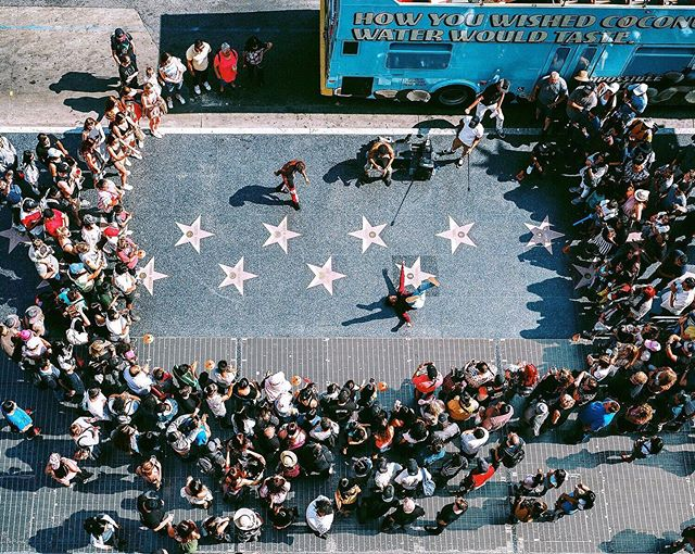 A charismatic group of Hollywood street performers working the crowd and breakin' on the walk of fame. @indiefilmlab @kodak #ektar100