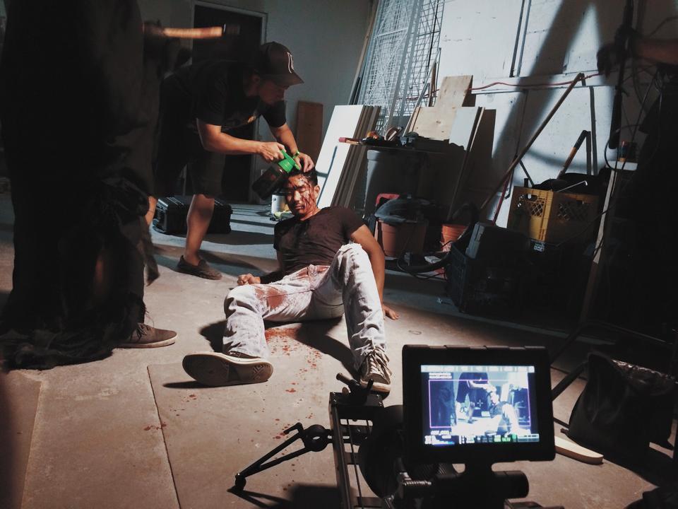 Dallas Harvey applying blood to Lee Shorten for the Run & Gun: Horror Promo