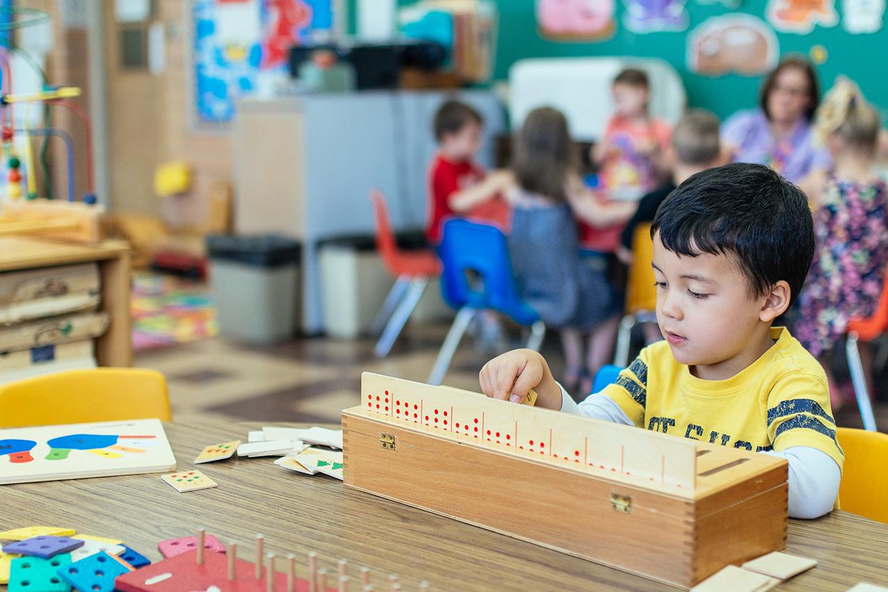 boy-playing-preschool-math-game.jpg