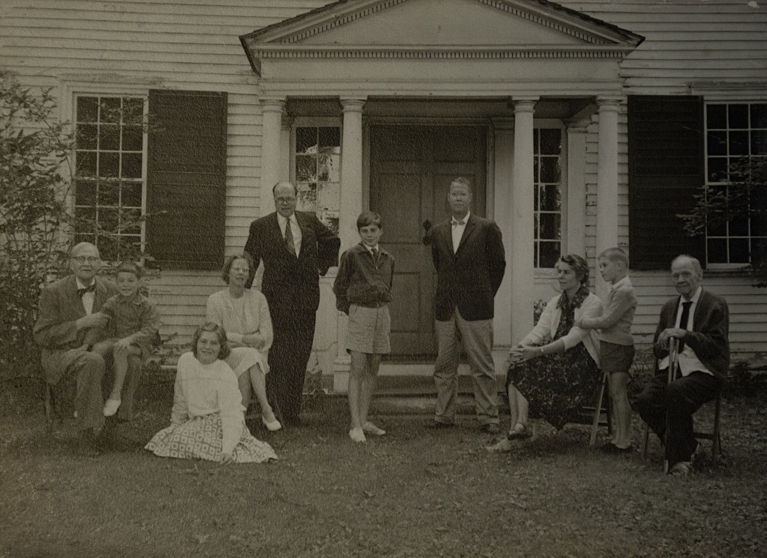 "John Huntington and his family in front of ""Forty Acres"""