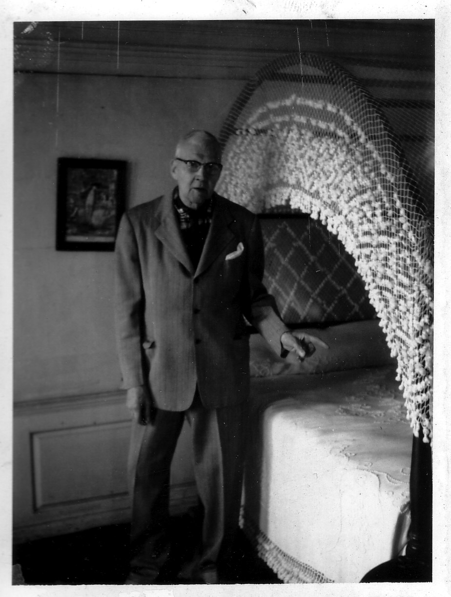 Dr. James Lincoln Hunting giving a tour, ca. 1936 - The ghostly imprint of a body can be seen on this bed.